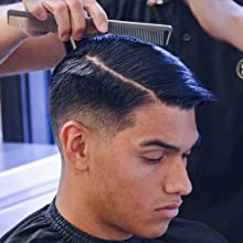 Working pomade through hair with comb