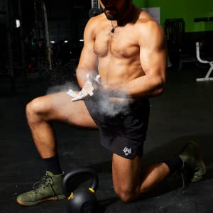 applying hand powder pre-workout