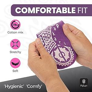 Hands stretching purple Pakari yoga socks