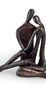A couple's embrace sculpture