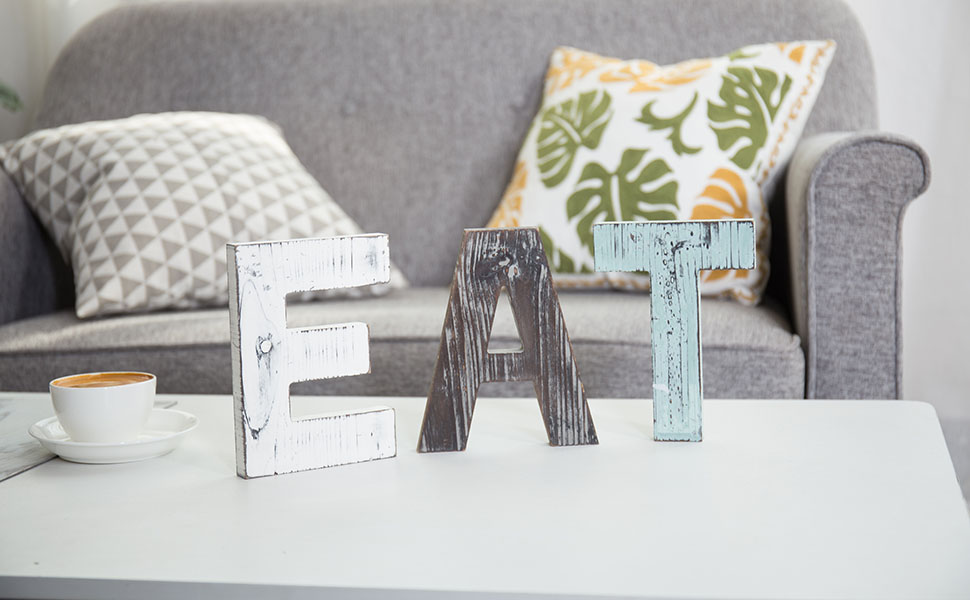 eat letter sign on coffee table