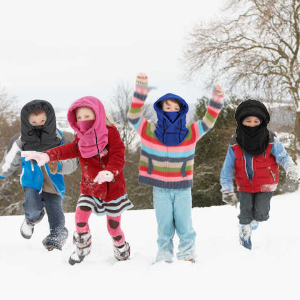 four children playing at snow day