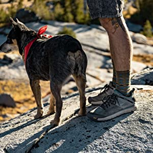 man hiking with his dog