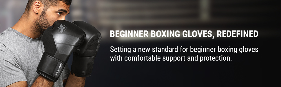 Athlete wearing Black S4 Boxing Gloves with hands up coving face