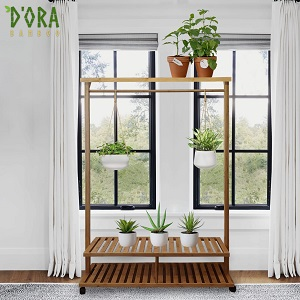 displaying its multi purpose use with house plants displayed on shelves and hanging on clothes rail
