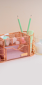 the rose gold pen holder that has a big drawer for office supplies, also holds pens, pencils, eraser