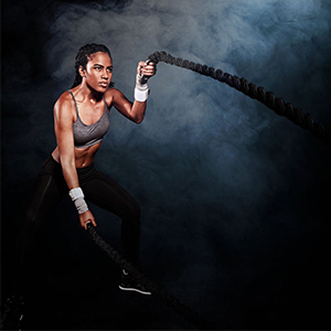 Incrediwear Girl Exercising with Battle Ropes
