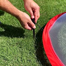 staking in pop up nets in grass