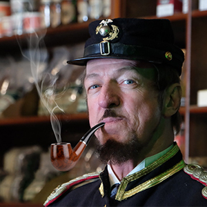 Smoking pipe at home.