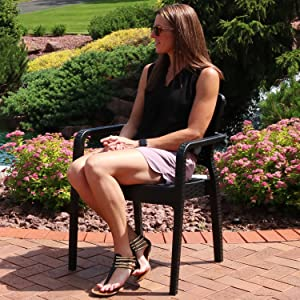 girl sitting in chair on patio