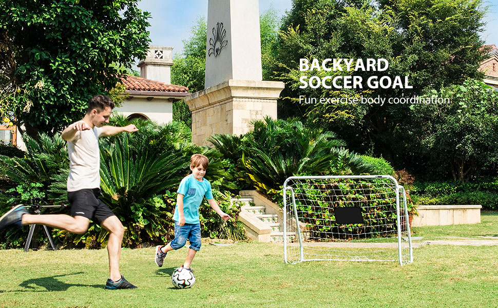 daddy playing soccer ball with kid with soccer goal