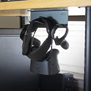 Removes desk clutter by mounting VR hardware under desk.