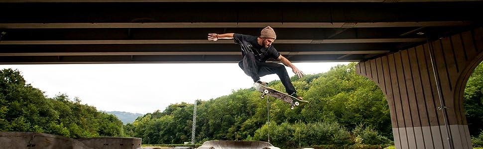 Skateboarding Jumping over Ramp