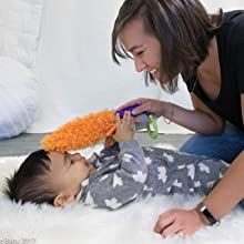 baby playing with mom and toy on plane