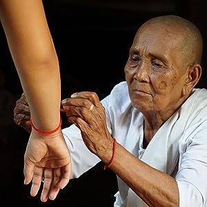 Bracelet rouge chance bonheur Crea&Co marque française moine tibétain yoga mantra méditation