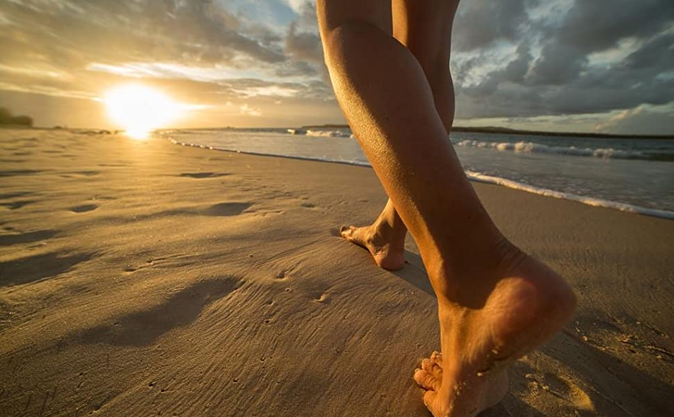 Walking barefoot on the sand.