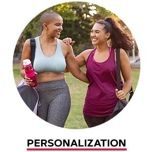 Two women wearing workout gear walking together. Personalization.