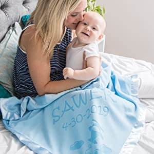 Mom and baby under customized baby blanket
