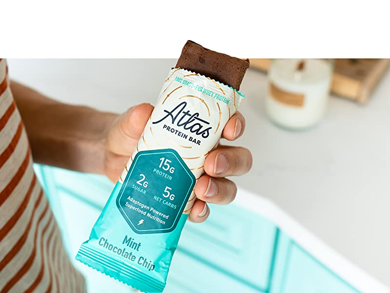 Holding Mint Chocolate Chip Atlas Bar in Kitchen