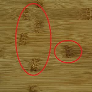 Close up of bamboo cutting board showing knots or steps present in all bamboo boards