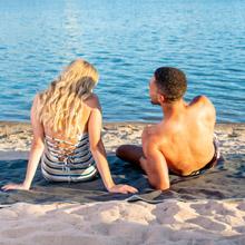 brawntide outdoor beach blanket sand sea couple picnic