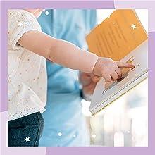 BABY PRESSING A SOUND BUTTON BOOK