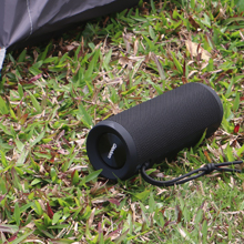 There is a Bluetooth speaker beside the tent