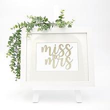 gold miss to mrs cake topper shown in keepsake frame