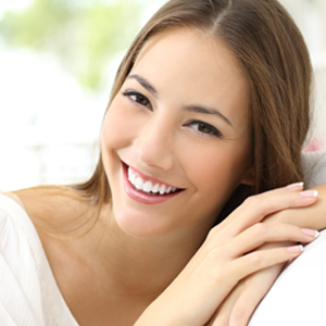 woman with perfect white smile looking at camera