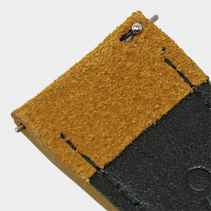 closeup of suede leather watch strap showing quick release spring bars