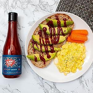 kpop gochujang sauce on eggs, toast, and avocado