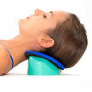 Woman laying on ground with hot and cold therapy pack under neck