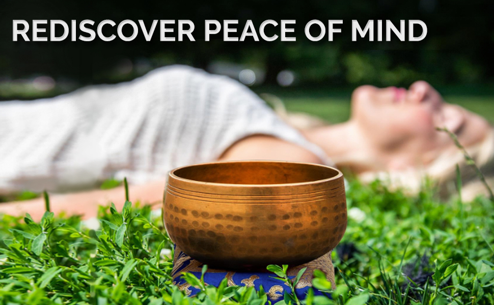Using The Ohm Store's Tibetan Singing Bowl with striker and the message: Rediscover Peace of mind