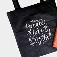black tote bag with white kassa iron on vinyl design adhered to it