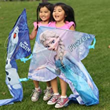 Two girls playing with Wind n Sun character kites