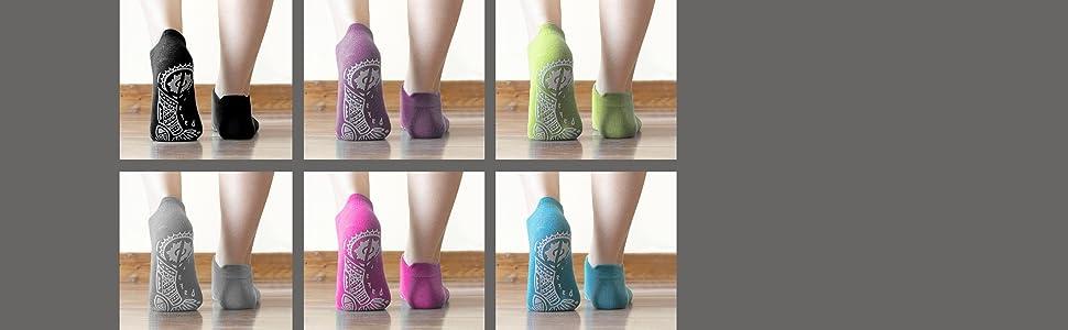 Six pairs of feet walking away wearing black, grey, purple, pink, green and blue Pakari yoga socks