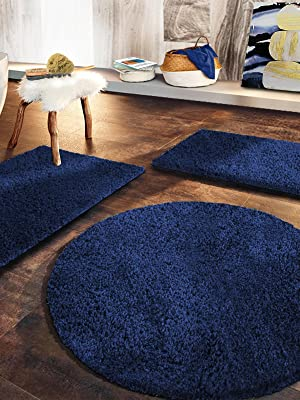 Rich navy blue baths mats in modern bathroom. Plush, shaggy bath mats, non - slip