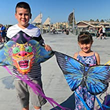 Kids playing with X-Kites on beach