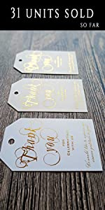 white tags with gold embossing letter