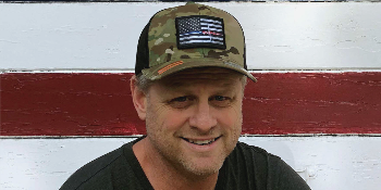 Guy with Pull Patch Multicam hat and removable patch