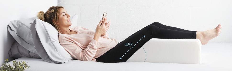 Woman with the Restorology Leg Wedge Pillow. Infographic depicting the 45 degrees of elevation.