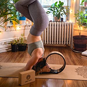 Headstand performed using a cork yoga mat from yoga world inside oblong studio