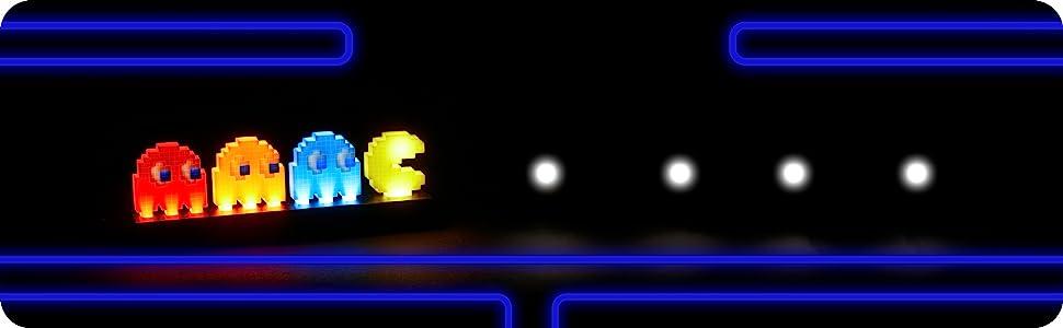 Pac man Iconos luz junto a rastro de puntos blancos