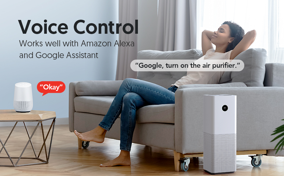 A lady is lying on the sofa and controlling the air purifier by voice command.