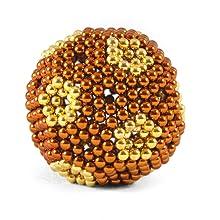 goldfish light and dark orange speks in a sphere