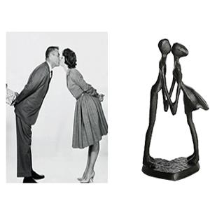 couple kiss figurine