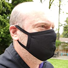 black cotton face mask on adult male