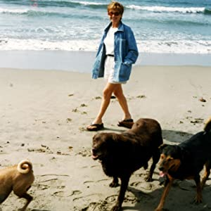 the story behind rocket and rex. my mom walking her rescue dogs on the beach in california.