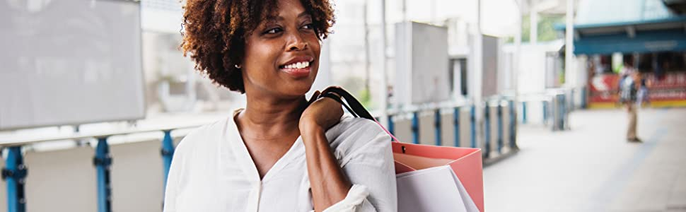 smiling woman holding bags