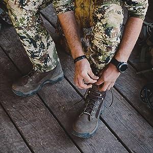 Man lacing his hunting boot